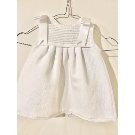 Vestido cuerpo de punto y falda de piqué blanca